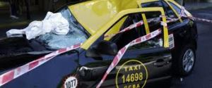 The aftermath of a suicidal woman landing on a taxi