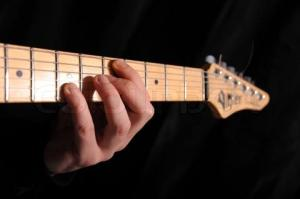 view-of-human-fingers-on-guitar-fret-board