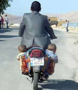 father and babies on a bike