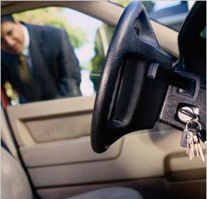 man-looking-into-car-keys-locked-in-ignition