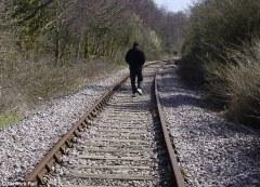 man on railway line