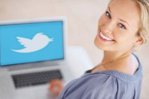 Woman in front of a computer with Twitter logo