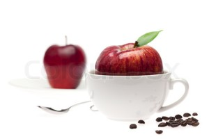 apples in a bowl, spoon and coffee beans isolated on white