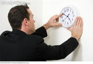 turning a clock's hands counterclockwise