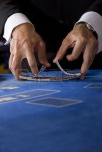 two-hands-shuffling-a-deck-of-cards-in-a-casino