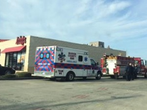 Fire and Ambulance Rescue trucks outside the Arby's restaurant where Laquaine got himself stuck in the ventilation shaft