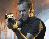 Keifer Sutherland with gun action shot