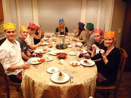 British wear paper crowns while they eat Christmas dinner