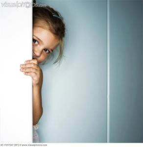 girl_hiding_behind_door