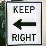 pointing left keep right sign