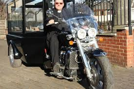 vicar on a motorbike